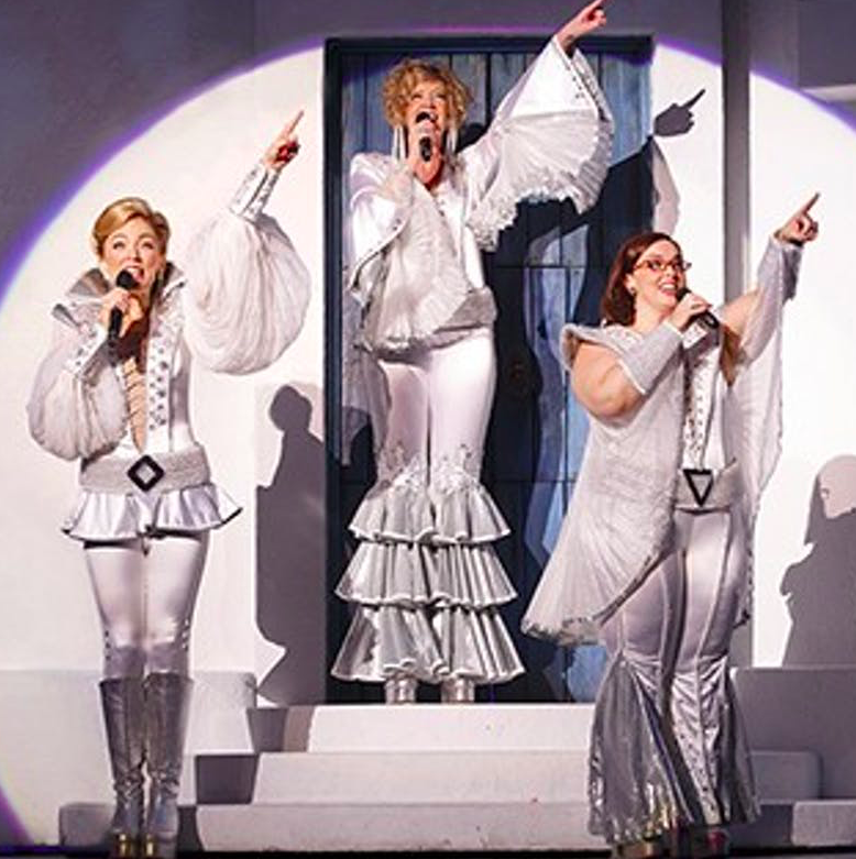 Image of three actresses from the Mama Mia farewell tour