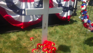image of a cross behind a flag